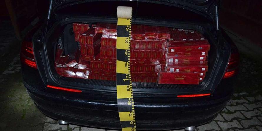 Țigări de 166.000 de lei confiscate și un Audi A8 indisponibilizat