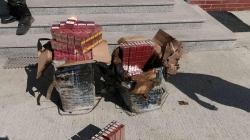 1.000 de pachete cu țigări de contrabandă au fost găsite de polițiști în vegetație